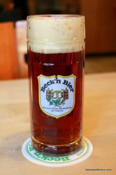 dark beer with head in mug