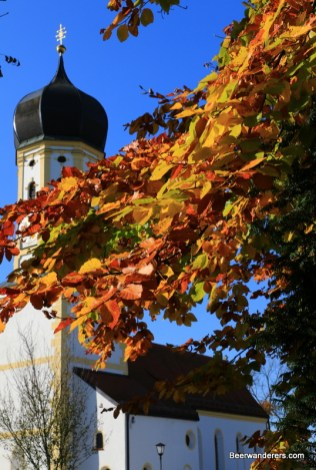 church tower with foliage
