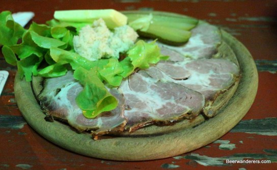 cold pork on wooden plate