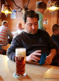 guy on phone with beer