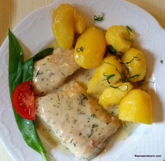 fish in sauce with potatoes
