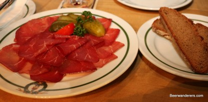 cold cuts on plate with bread