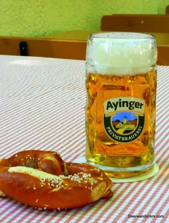 golden beer in mug with pretzel