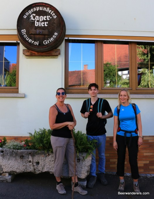 hikers in front of brewery