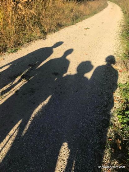 shadows of beer hikers
