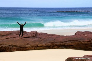 girl on rock on beach