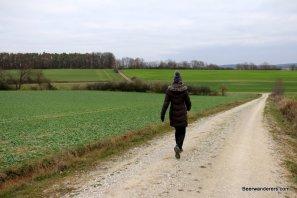 woman walking backroads