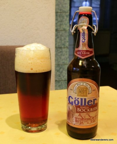 dark amber beer in glass with bottle