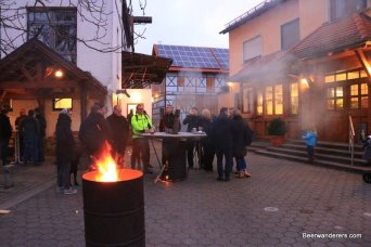 people outside in winter with a fire