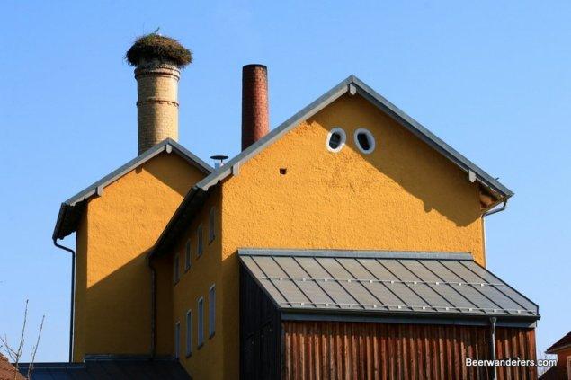stork nest on brewery chimney