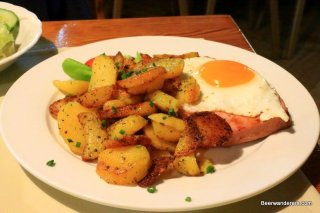meat with egg and potatoes on plate