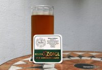 unfiltered amber beer in mug with coaster