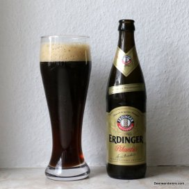 dark weissbier in glass with bottle