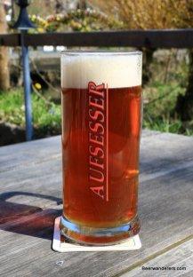 unfiltered amber beer in mug