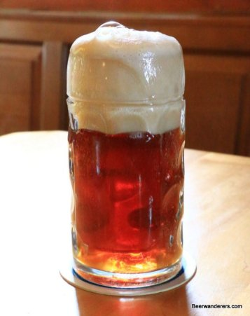 amber beer in mug with big head