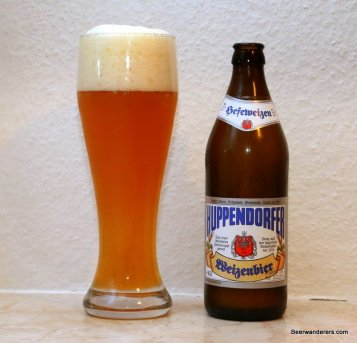 weissbier in glass with bottle