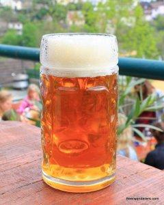 unfiltered light amber beer in mug