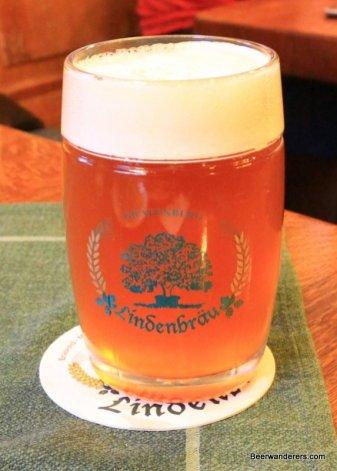 light unfiltered amber beer in mug