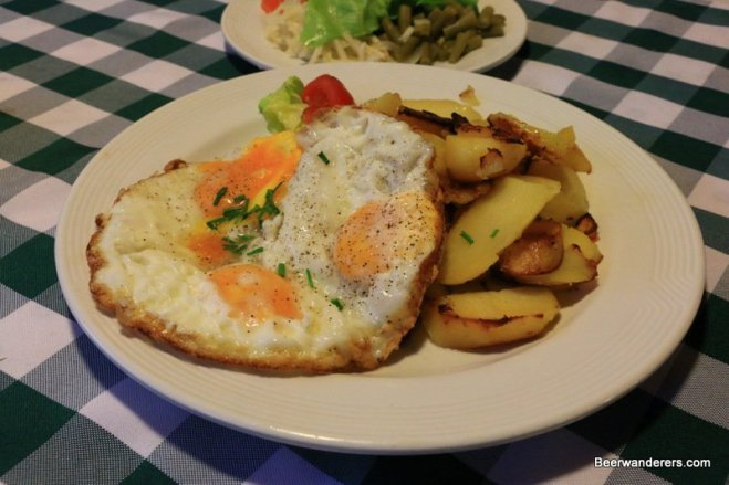 fried eggs and fried potatoes