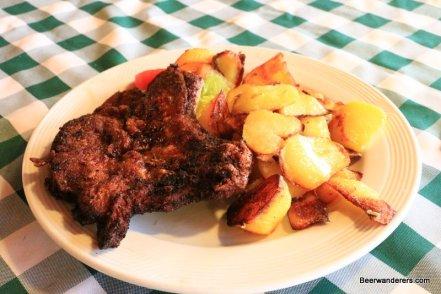 fried pork chop and friend potatoes