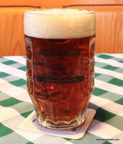 dark amber beer in mug
