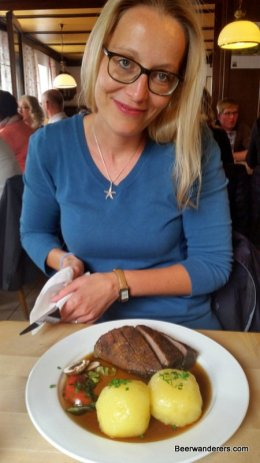 pretty blond woman with duck and dumplings