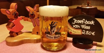 golden beer in mug with goat logo