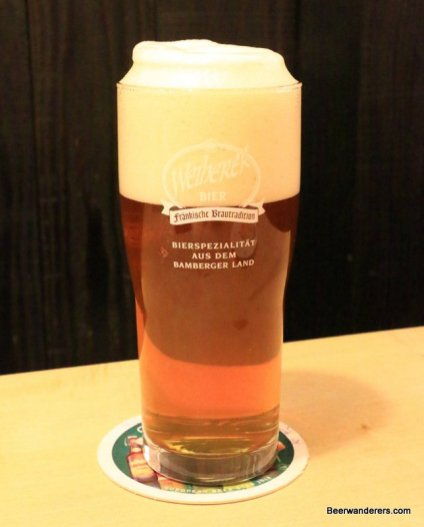 unfiltered amber beer in glass