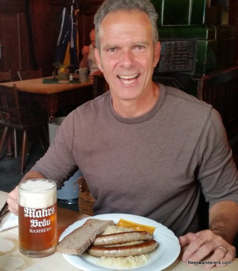 guy happy with beer and brats