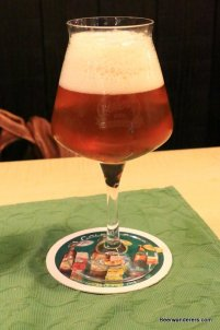 unfiltered amber beer in wine glass