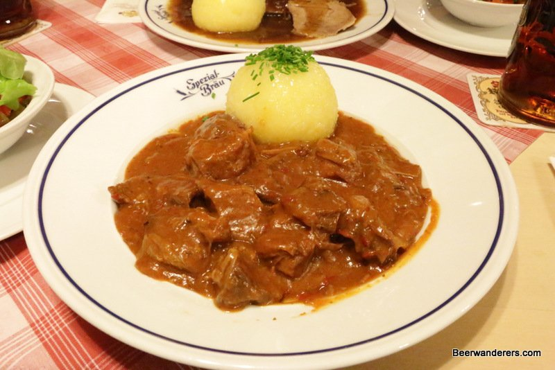 meat in sauce with dumpling