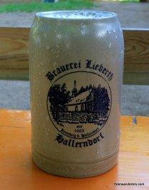 beer in ceramic mug with log