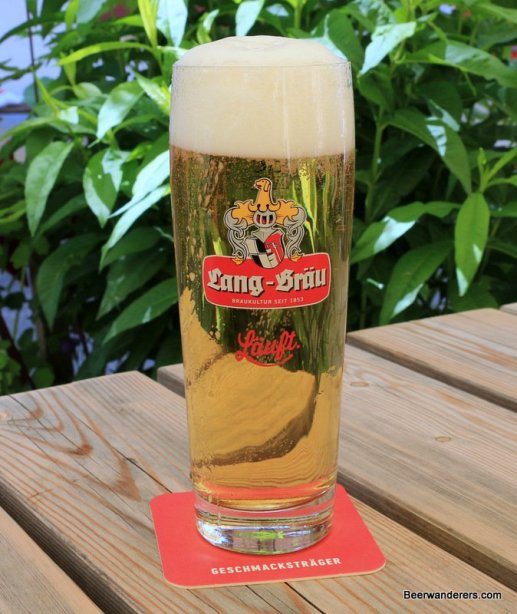 yellow beer with big head in glass