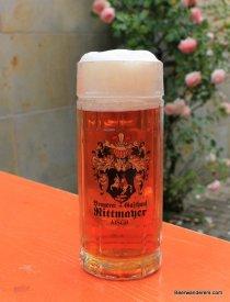 amber beer in logo mug with big head