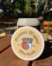 beer in ceramic mug with beer mat