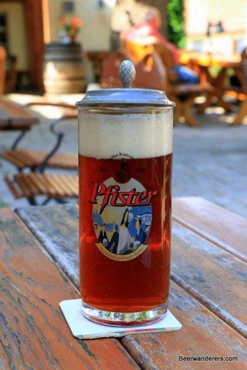 unfiltered dark beer in logo mug with pewter lid
