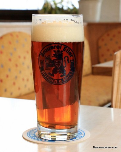 amber beer in logo glass