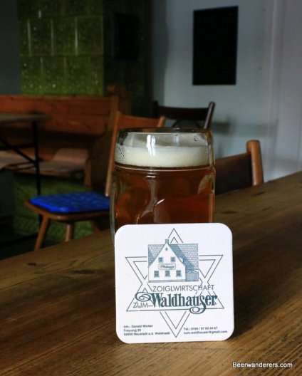 unfiltered beer in mug with coaster