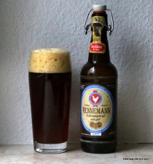 darl beer in glass with bottle