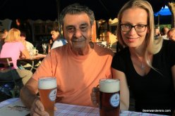 two people in biergarten with beers