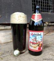 dark beer in glass with bottle