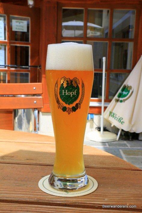 weissbier in glass with Hopf logo
