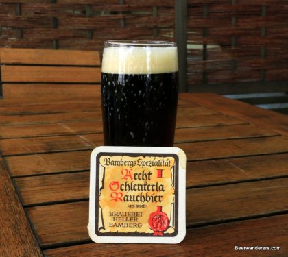 dark beer in glass with coaster