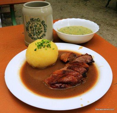 duck breast with dumpling and beer in krug