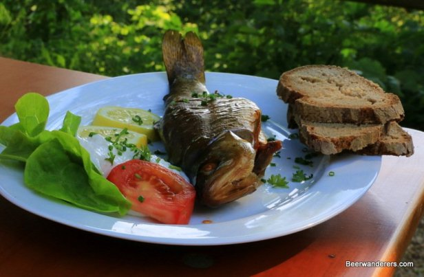 whole smoked fish with bread