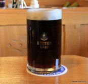 dark beer in logo glass