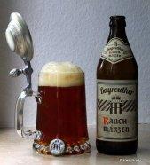 amber beer in mug with bottle