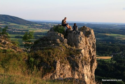 people sitting on rocky outcropping
