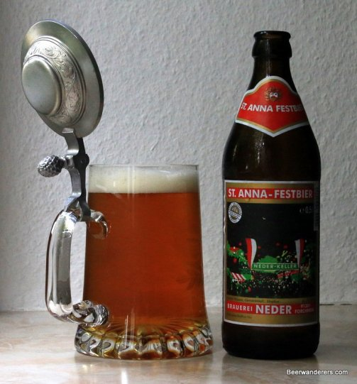 beer in mug with pewter lid and bottle