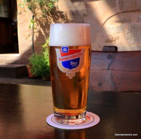 golden beer with big head in logo glass